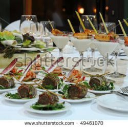 stock-photo-luxury-banquet-table-setting-in-restaurant-table-with-the-wineglasses-snacks-and-cocktails-49461070